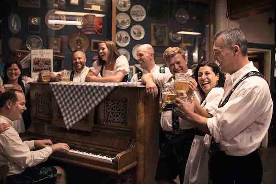 People Singing and playing Piano Oktoberfest Munich